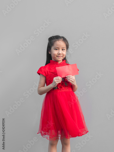 c1d203b7df Cute Asian girl in chinese cheongsam and Tradition Chinese dress with red  envelope