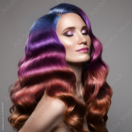 Portrait of beautiful woman with long curly colorful hair Canvas Print