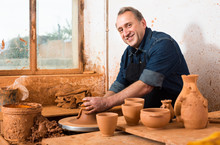 Elderly Master At The Pottery Workshop.