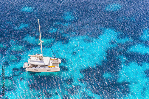Leinwand Poster Beautiful bay with sailing boat yacht catamaran