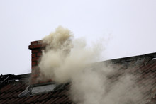Smoke From The Chimney Of A House Fueled With Coal.
