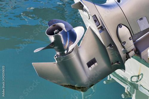 Fototapeta  Foot aft of grey used outboard engine