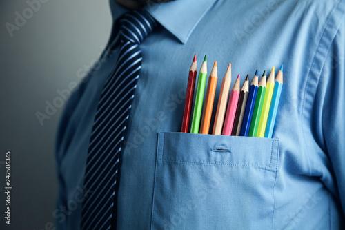 Fototapeta Businessman in blue shirt with colorful pencils in pocket. obraz na płótnie