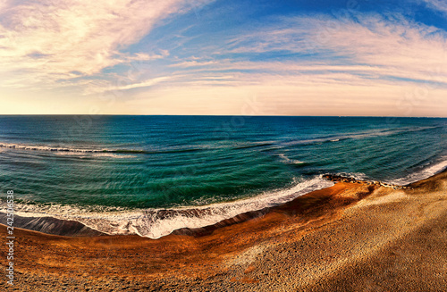 Fotografia  Panorama seascape view above the ocean with sand water and scenic sky