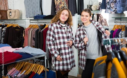 Female friends posing in new coat Slika na platnu