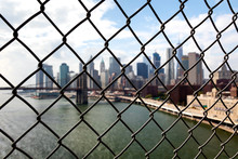 New York Brooklyn Bridge And Downtown Through The Wired Mesh
