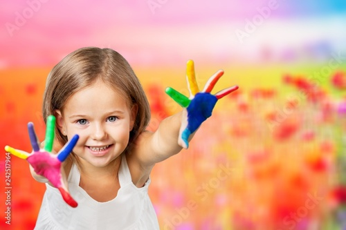 Carta da parati Cute little girl with colorful painted hands on white background