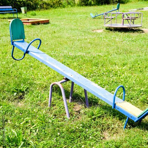 Foto  Children's rocking chair on the playground.
