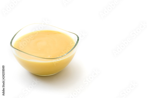 Bowl of homemade vanilla custard isolated on white background Poster Mural XXL