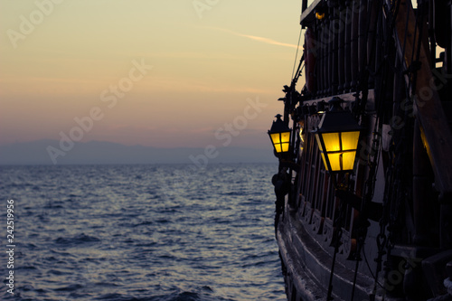 Foto auf AluDibond Schiff vintage lantern outside overboard vintage ship perspective outdoor romantic sea photography, empty space for copy or text on post card composition concept