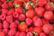 Fresh Raspberries And Strawberries Background Closeup