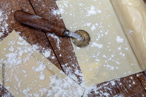 Fotografie, Obraz  Dough and raw pastel, on rustic wooden table
