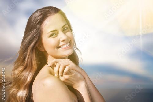 Carta da parati Young beautiful woman on beach at sunny day