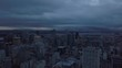 Aerial view of a beautiful modern downtown city during a striking cloudy sunrise. Taken in Montreal, Quebec, Canada.