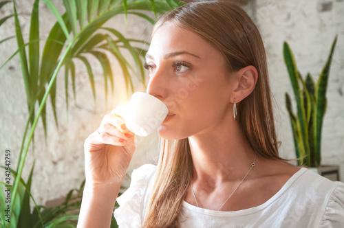 Fotografie, Obraz  Young beautiful woman drinking espresso coffee