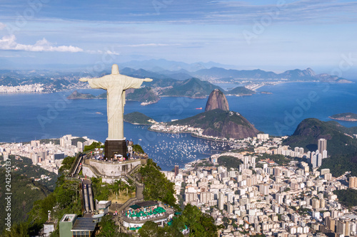 Aerial view of Christ the Redeemer, Sugarloaf and Rio de Janeiro cityscape, Brazil.