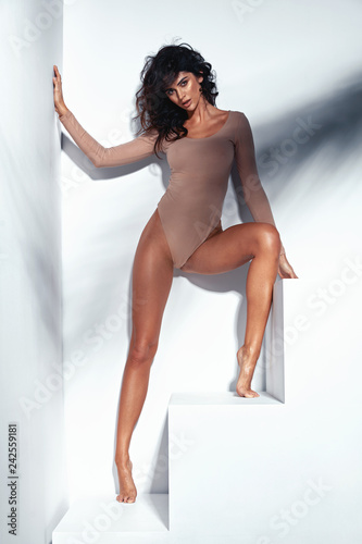 Tuinposter Artist KB Portrait of a tanned, sensual latina lady
