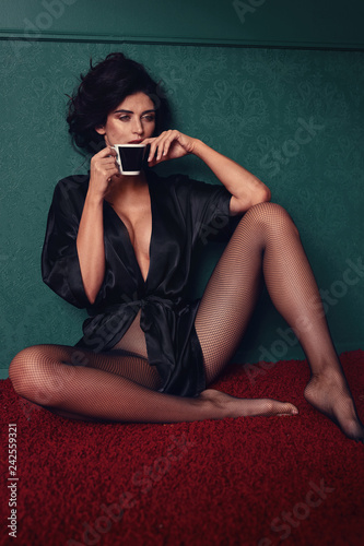 Staande foto Artist KB Portrait of a relaxed latina lady drinking coffee