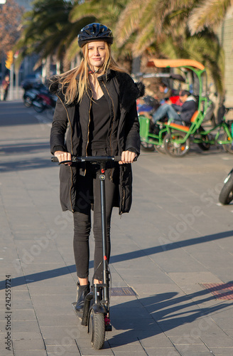 Woman riding an electric scooter in winter