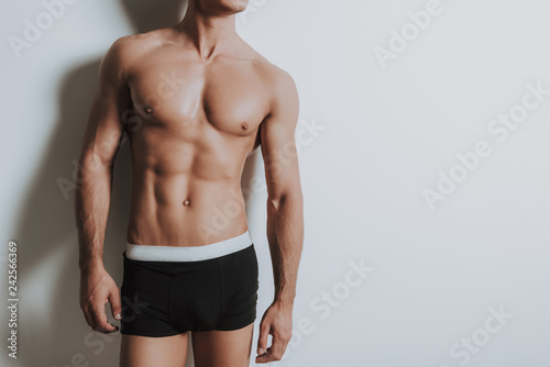 Obraz Young shirtless athletic man standing in black underwear - fototapety do salonu