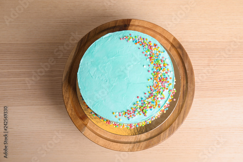 Vászonkép Fresh delicious birthday cake on wooden background, top view