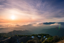 Panoramic View Of A Sunset Over A Sea Of Clouds Covering South San Francisco Bay Area; Beautiful Rolling Hills In The Foreground; View From Mt Hamilton, San Jose