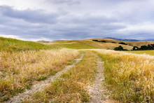 Walking Trail Among Hills And Valleys Covered In Dry Grass, South San Francisco Bay Area, San Jose, California