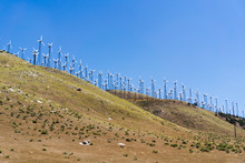 Many Old And Small Wind Turbines On The Top Of Golden Hills In Kern County, South California