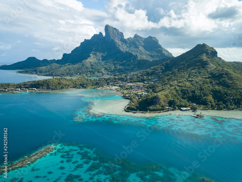 Fotografie, Obraz Aerial image from a drone of blue lagoon and Otemanu mountain at Bora Bora island, Tahiti, French Polynesia, South Pacific Ocean (Bora Bora Aerial)