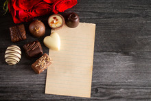 Blank Page For A Love Letter With Chocolates And Roses