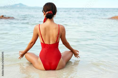 Yoga Meditation. Woman Relaxing At Sea Beach Back View