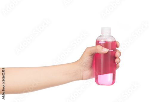 Fotografía  hand holding plastic bottle isolated on white background