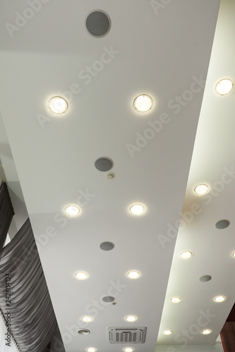 Modern layered ceiling with embedded lights and red cloth