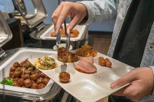 Fotobehang Kruidenierswinkel Tourists taking food in the buffet hotel restaurant