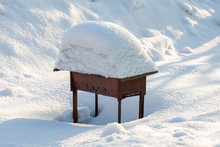 Metal Brazier Covered With Pile Of Snow, Winter Outdoors