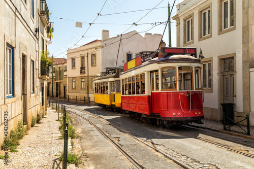 Fototapeta Yellow and red tram on old streets of Lisbon, Alfama, Portugal, popular touristic attraction and destination. obraz na płótnie