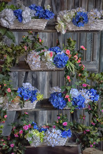 White And Blue Flowers In Wicker Baskets