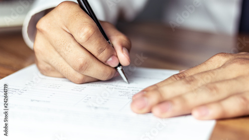 Fototapeta Businessman signing a document in office obraz