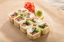 Delicious Tortilla Roll With Beef, Cheese And Vegetables With Ginger And Wasabi On Paper Background