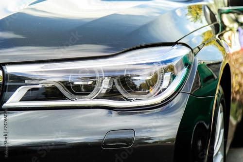 Photo  beautiful LED optics of a new modern car outdoors