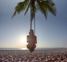 Woman Sitting On The Wooden Swing At The Sea Beach, Alone Feeling Boring Upset See The Sunset