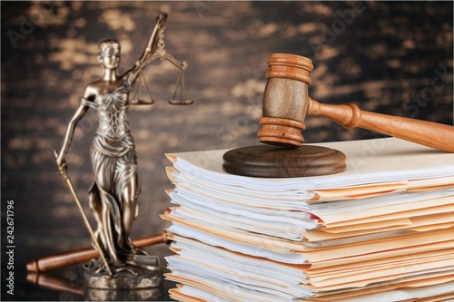 Judge hammer and documents on background