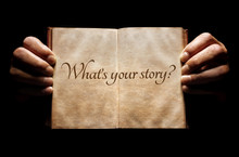 What's Your Story? Hands Holding An Open Book Background With Question