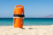 Orange Rescue Buoy On The Beach