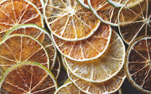 Dried Colorful Slices Of Lemon The Lime And Orange Background