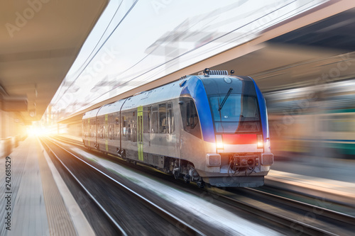 Railroad travel passenger train with motion blur effect, industrial concept, tourism.