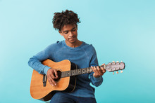 Handsome Young African Man Playing A Guitar