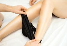 Man Is Taking Off Woman's Black Panties.