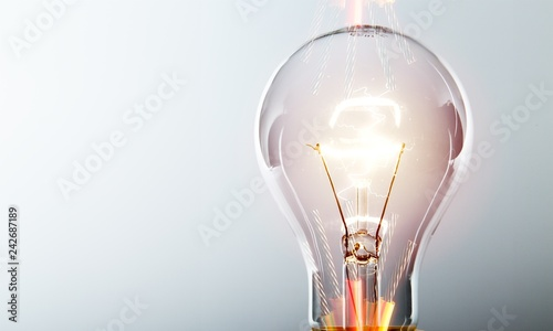 Slika na platnu Glowing yellow light bulb, busienss idea concept