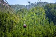 Cable Car Taking Tourists To The Top Of Grouse Mountain, Vancouver, Canada